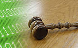 Image of green binary code and a gavel. The Clerk's Office Goes Green with Less Paper in the Courtroom