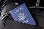 U.S. Passport in pocket of black bag